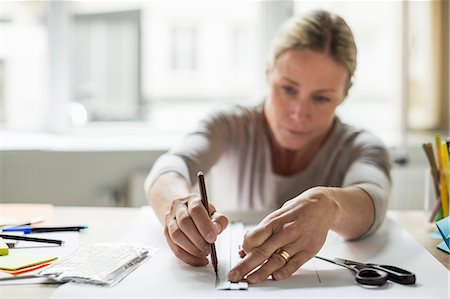 paper - Businesswoman drawing line using ruler on paper Stock Photo - Premium Royalty-Free, Code: 698-07588446