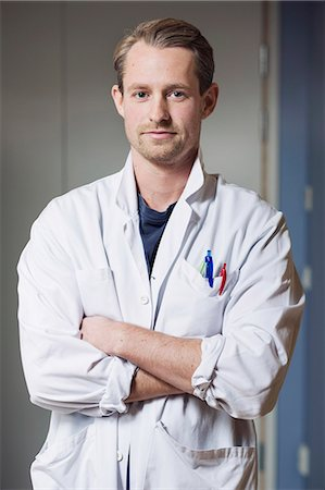 Portrait of confident male doctor with arms crossed in hospital Stock Photo - Premium Royalty-Free, Code: 698-07588481