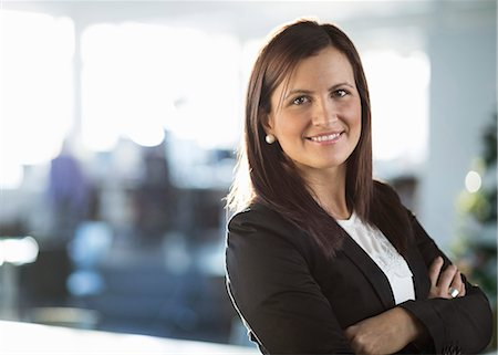 portrait - Portrait of confident businesswoman standing arms crossed in office Stock Photo - Premium Royalty-Free, Code: 698-07588497