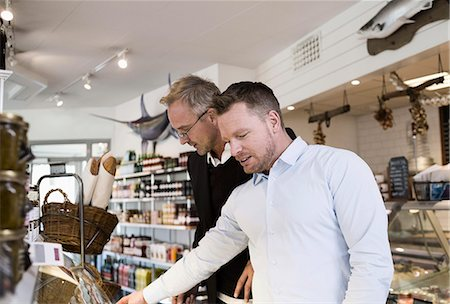 Businessmen selecting food at cafe Stock Photo - Premium Royalty-Free, Code: 698-07588556