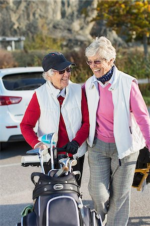 senior lady walking - Smiling senior women walking with golf bag outdoors Stock Photo - Premium Royalty-Free, Code: 698-07611447