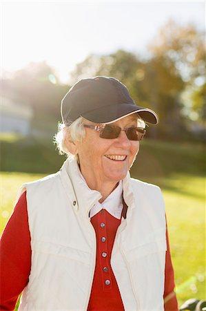 Senior woman smiling outdoors Stock Photo - Premium Royalty-Free, Code: 698-07611455