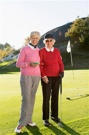 Full length portrait of senior female golfers standing on golf course Stock Photo - Premium Royalty-Free, Code: 698-07611461