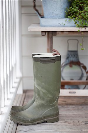 pair - Rubber boots by railing Stock Photo - Premium Royalty-Free, Code: 698-07611508
