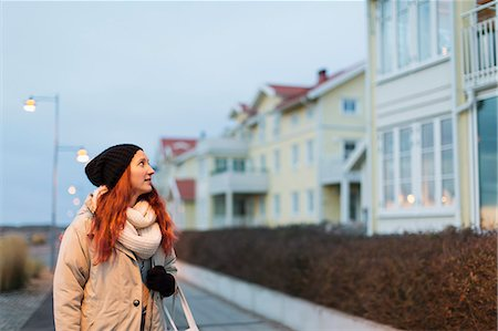 residential - Teenage girl in warm clothing looking at buildings Stock Photo - Premium Royalty-Free, Code: 698-07611540