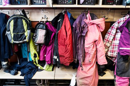 Winter coats and backpacks in wardrobe at kindergarten Stock Photo - Premium Royalty-Free, Code: 698-07611566