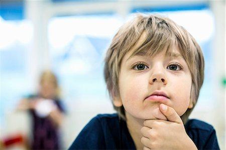 Little boy looking away in kindergarten Stock Photo - Premium Royalty-Free, Code: 698-07611560