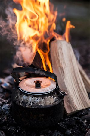 fire - Teapot with firewood burning in background Stock Photo - Premium Royalty-Free, Code: 698-07611699