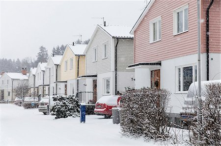 Houses in row during winter Stock Photo - Premium Royalty-Free, Code: 698-07611702