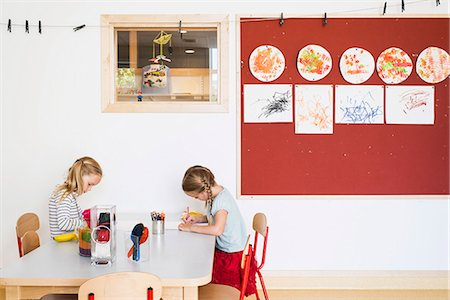 drawing (artwork) - Little girls drawing at table in house Stock Photo - Premium Royalty-Free, Code: 698-07611725