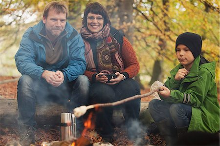 Family camping in forest Stock Photo - Premium Royalty-Free, Code: 698-07611809