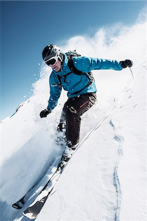 Full length of man skiing on mountain slope Stock Photo - Premium Royalty-Free, Code: 698-07611800