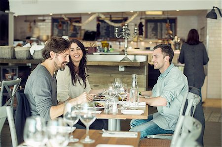friend - Happy friends discussing at restaurant table Stock Photo - Premium Royalty-Free, Code: 698-07611870