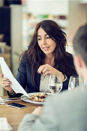relationship - Businesswoman discussing with male colleague at restaurant table Stock Photo - Premium Royalty-Free, Code: 698-07611886