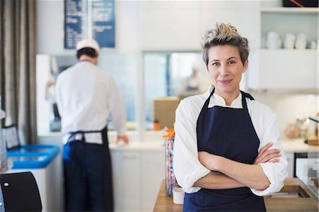Portrait of confident female owner standing arms crossed in cafe Stock Photo - Premium Royalty-Free, Code: 698-07611970