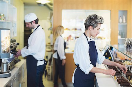 europe coffee shop - Workers working in cafe Stock Photo - Premium Royalty-Free, Code: 698-07611972