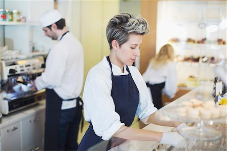 Mid adult female worker working at cafe Stock Photo - Premium Royalty-Free, Code: 698-07611973