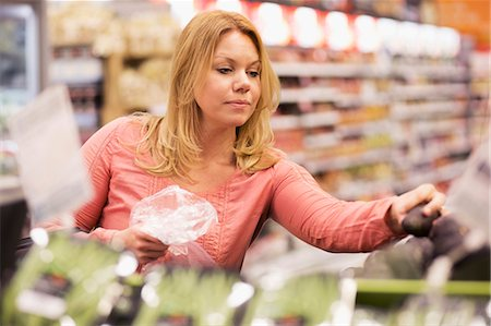 purchase - Woman buying groceries in supermarket Stock Photo - Premium Royalty-Free, Code: 698-07635215