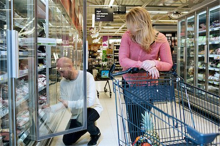 shop - Mid adult couple buying groceries in supermarket Stock Photo - Premium Royalty-Free, Code: 698-07635220