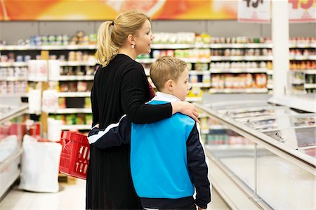 Rear view of mother and son shopping groceries in supermarket Stock Photo - Premium Royalty-Free, Code: 698-07635232