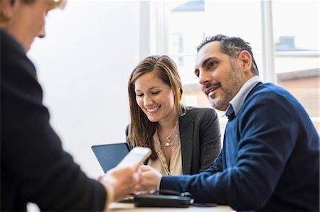 Businesspeople in meeting at office desk Stock Photo - Premium Royalty-Free, Code: 698-07635345