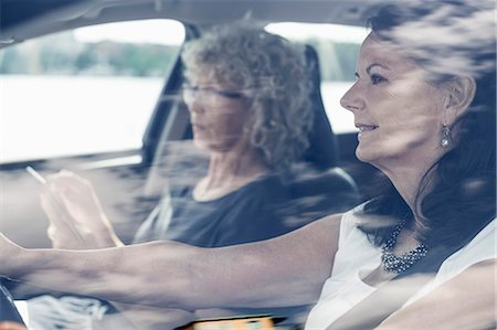 road trip - Senior female friends on road trip Stock Photo - Premium Royalty-Free, Code: 698-07635405