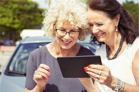 Happy senior women using digital tablet outdoors Stock Photo - Premium Royalty-Free, Code: 698-07635408