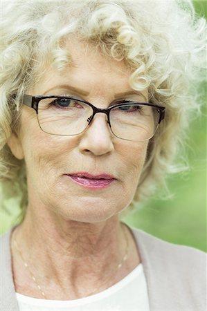 Portrait of confident senior woman in park Stock Photo - Premium Royalty-Free, Code: 698-07635419