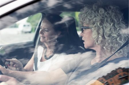 friend (female) - Senior women discussing over digital tablet in car Stock Photo - Premium Royalty-Free, Code: 698-07635411