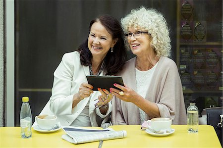 european cafe bar - Happy senior women with digital tablet looking away at outdoor cafe Stock Photo - Premium Royalty-Free, Code: 698-07635434