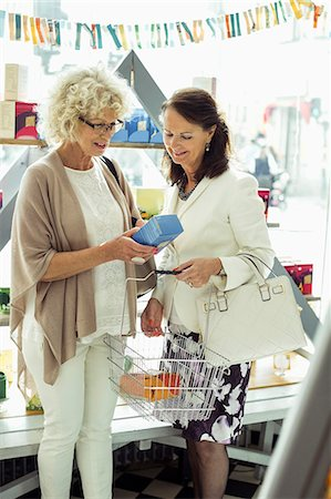 purchase - Senior female friends shopping in store Stock Photo - Premium Royalty-Free, Code: 698-07635430