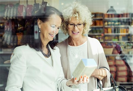 senior women - Senior women checking instructions on product in store Stock Photo - Premium Royalty-Free, Code: 698-07635432