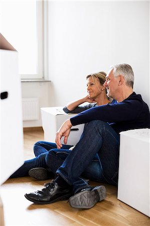 renting - Mature couple relaxing after moving into their new house Stock Photo - Premium Royalty-Free, Code: 698-07635472