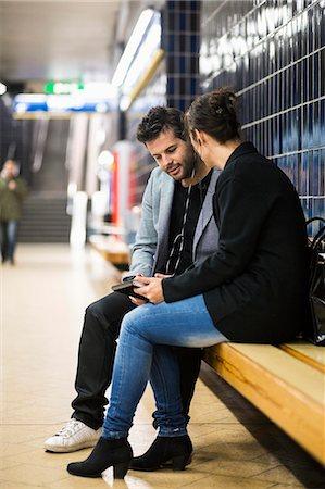platform - Full length of business people talking at subway station Stock Photo - Premium Royalty-Free, Code: 698-07635483