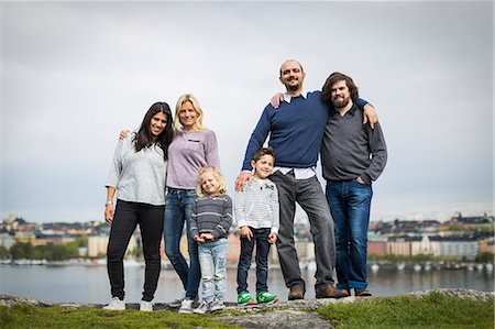 Full length portrait of homosexual families standing together at lakeshore Stock Photo - Premium Royalty-Free, Code: 698-07635519
