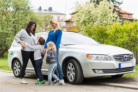 Playful homosexual family standing by car on street Stock Photo - Premium Royalty-Free, Code: 698-07635528