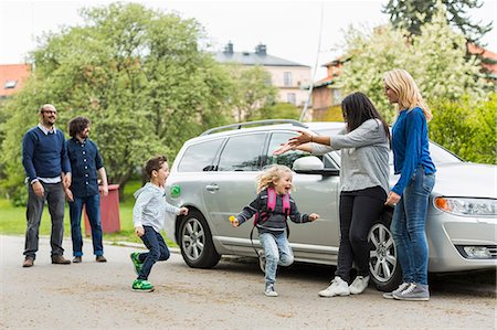 Homosexual families enjoying by car on street Stock Photo - Premium Royalty-Free, Code: 698-07635529