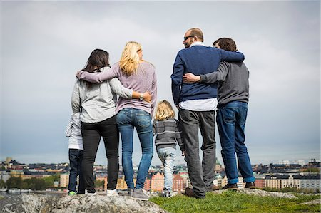 Full length rear view of homosexual families standing at lakeshore Stock Photo - Premium Royalty-Free, Code: 698-07635520