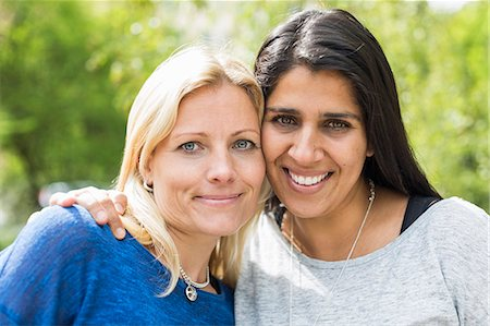 Portrait of affectionate lesbian couple at park Stock Photo - Premium Royalty-Free, Code: 698-07635536