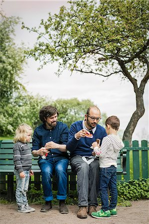 Full length of male homosexual family spending leisure time at park Stock Photo - Premium Royalty-Free, Code: 698-07635538
