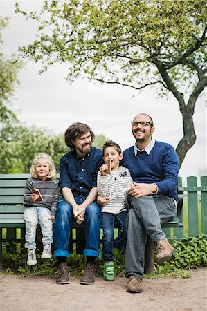 Happy male homosexual family spending leisure time at park Stock Photo - Premium Royalty-Free, Code: 698-07635539