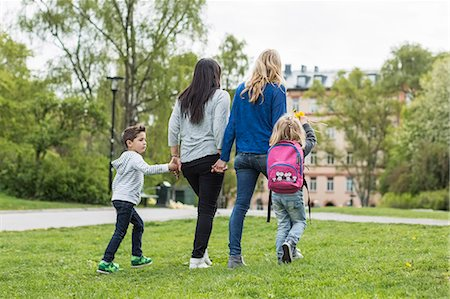 Rear view of female homosexual family walking in park Stock Photo - Premium Royalty-Free, Code: 698-07635532