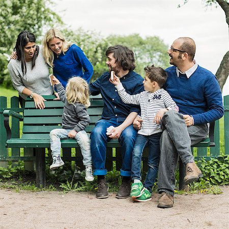 Homosexual families spending leisure time in park Stock Photo - Premium Royalty-Free, Code: 698-07635540