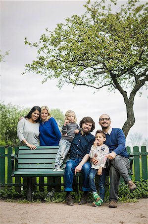 Portrait of homosexual families at park Stock Photo - Premium Royalty-Free, Code: 698-07635541