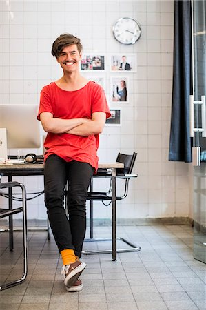 Full length portrait of smiling young businessman with arms crossed in new office Stock Photo - Premium Royalty-Free, Code: 698-07635607