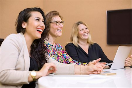 Happy businesswomen in meeting at board room in creative office Stock Photo - Premium Royalty-Free, Code: 698-07635628