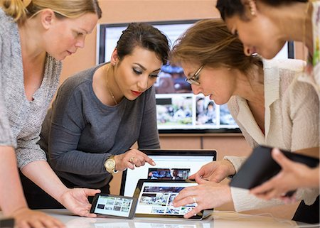 displaying - Female photo editors discussing over digital tablet in creative office Stock Photo - Premium Royalty-Free, Code: 698-07635646