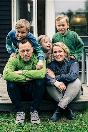 Portrait of happy family on porch Stock Photo - Premium Royalty-Free, Code: 698-07635677