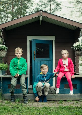 Portrait of siblings sitting on porch Stock Photo - Premium Royalty-Free, Code: 698-07635678