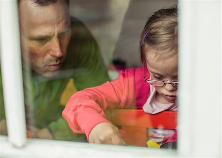 View of father and daughter looking down through window Stock Photo - Premium Royalty-Free, Code: 698-07635688